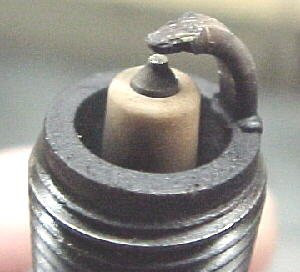 Reading Spark Plugs >> Plug suffering from mild pre-ignition damage left, normal plug right